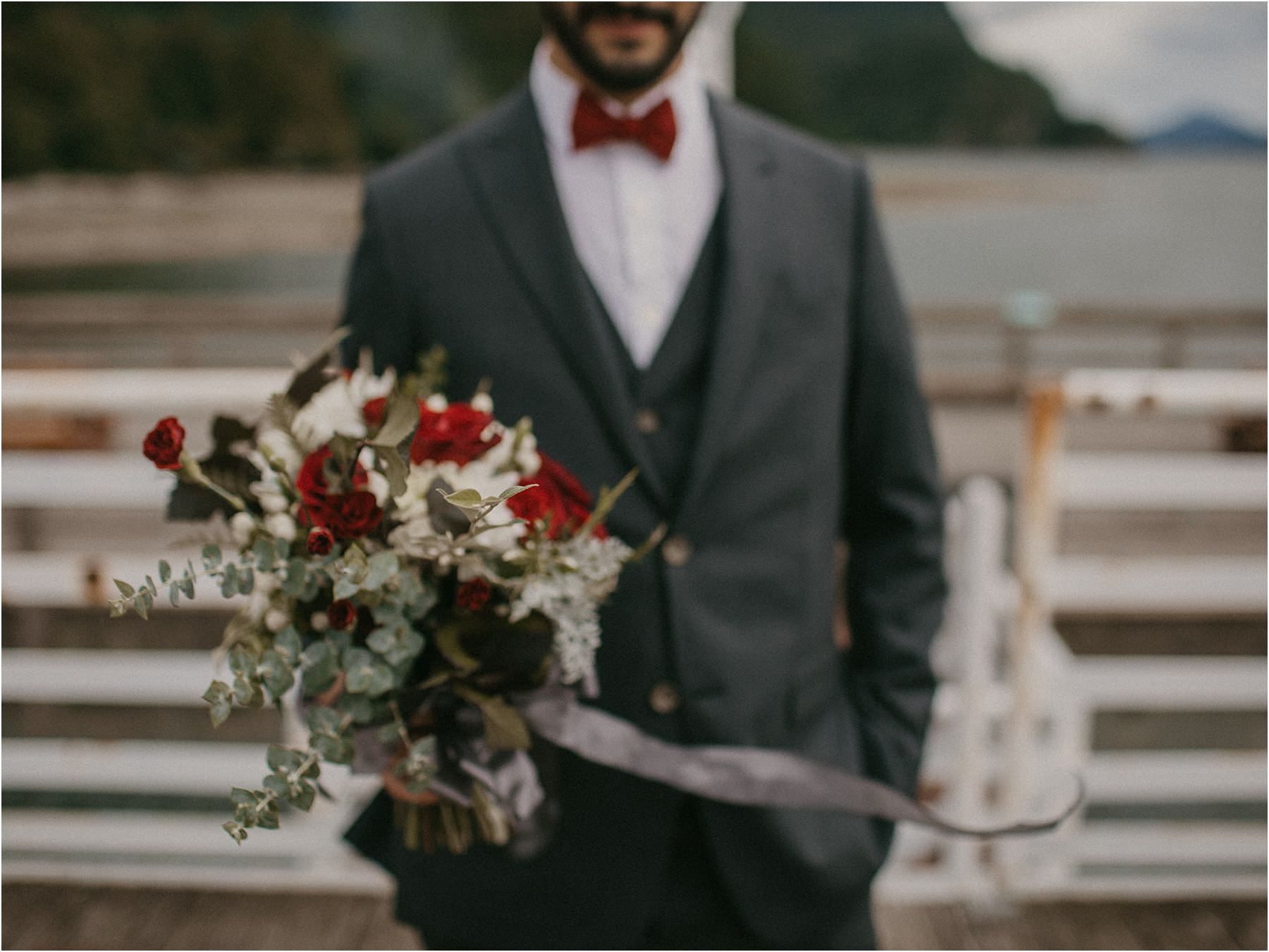 Groom holding bride's bouquet for his Squamish Micro Wedding