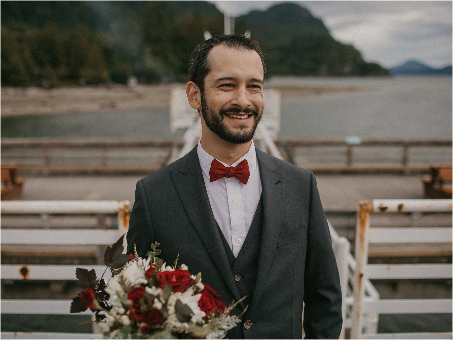 Groom smiling and looking off in the distance before his Squamish Micro Wedding