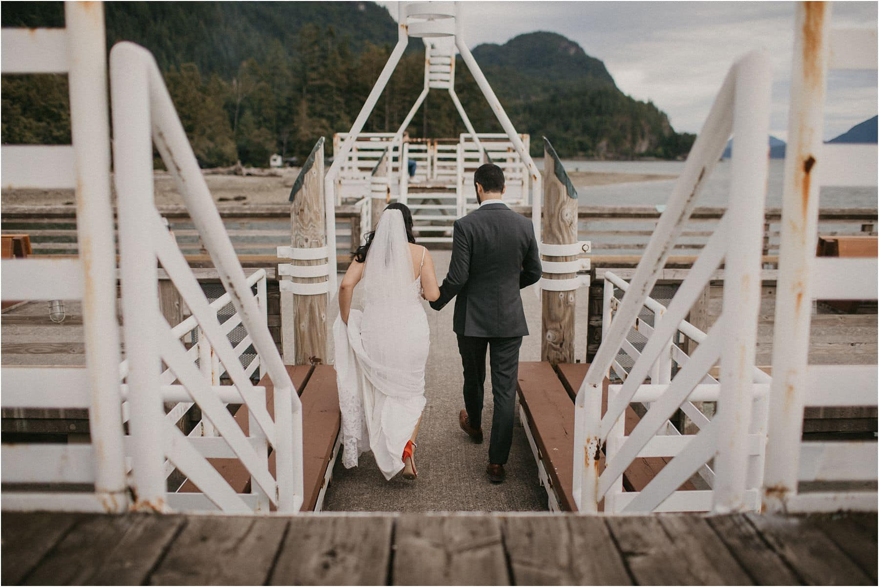 bride and groom holding hands and walking away to their Squamish Micro Wedding