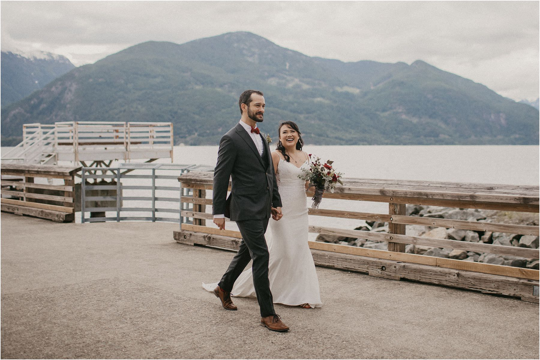front photograph of bride and groom walking to their Squamish Micro Wedding