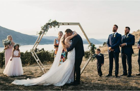 poplar grove winery wedding - Bride and groom first kiss at wedding ceremony