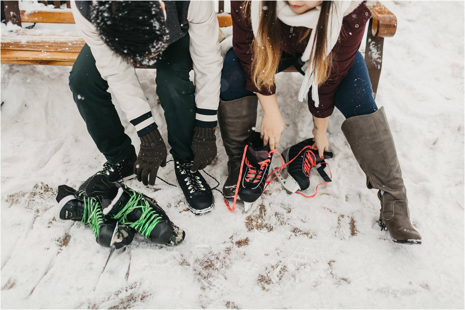 Top 5 Locations for your engagement shoot in vancouver - A couple putting on their ice skates and getting ready to skate on the frozen pond on top of grouse mountain.
