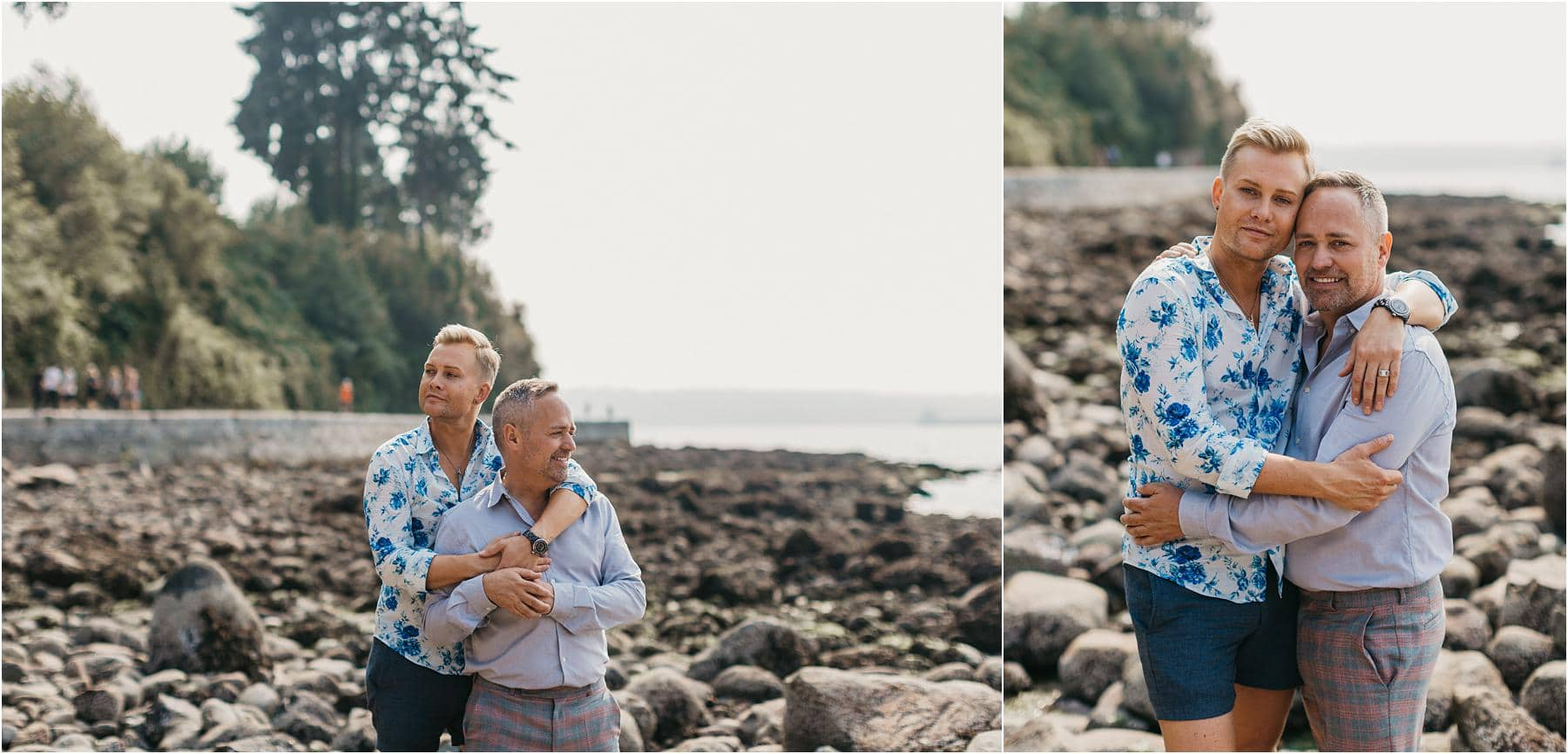 Same sex couple hugging while standing on the rocky beach at third beach in stanley park - Top 5 Locations for your engagement shoot in vancouver